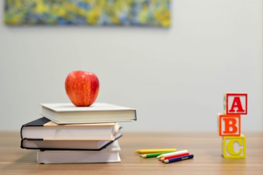 image of books, apple and nursery blocks for website J&J Commercial Finance Services page