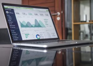 image of laptop with graphs on for website J&J Commercial Finance
