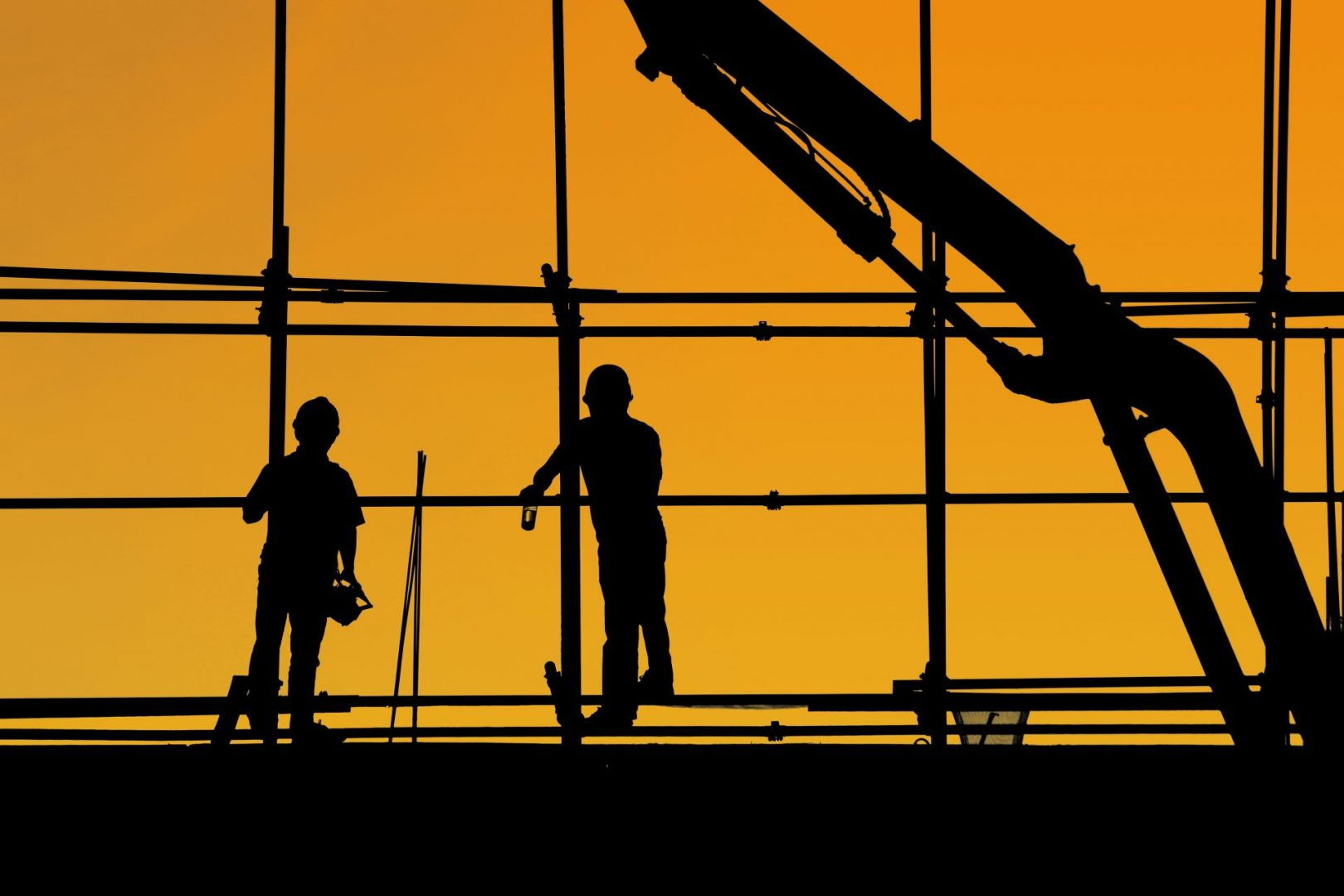 Silhouette image of works on scaffolding for website J&J Commercial Finance